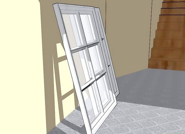 Hoe maak je een hangende portrethouder met een oud raam