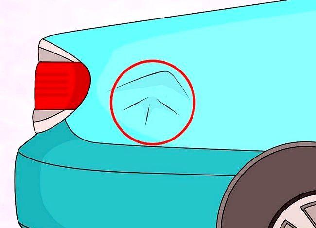 Hoe de deuk uit een auto met een föhn te verwijderen