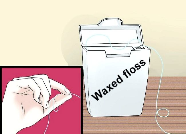 Titel afbeelding Floss With Braces Step 1